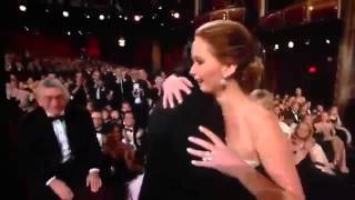 Jennifer Lawrence falls while receiving Best Actress Oscar