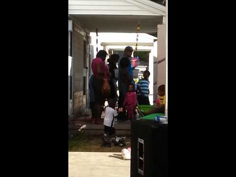 Man cranking up at party in West Tampa projects