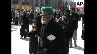 Shiites gather for festival, self-flagellation, plus Baghdad demo