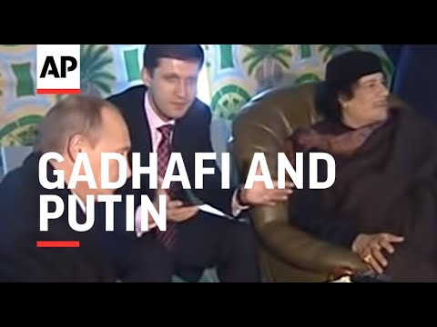 Gadhafi and Putin meet at fireside Bedouin tent