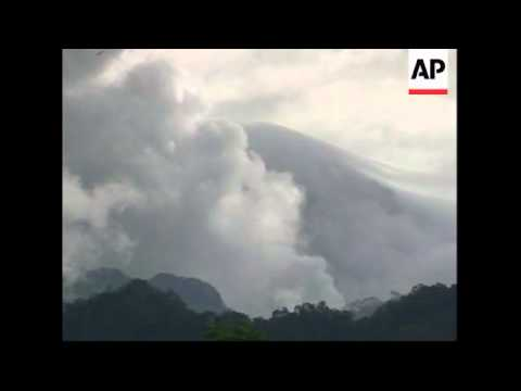 Mount Kelud volcano spitting out fresh clouds of smoke
