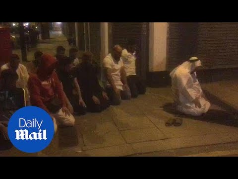 Muslims pray in Finsbury Park after witnessing attack - Daily Mail