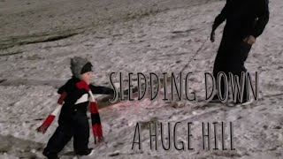 TODDLER GOES SLEDDING DOWN A HUGE HILL