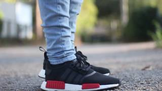 adidas nmd black w red tabs on feet