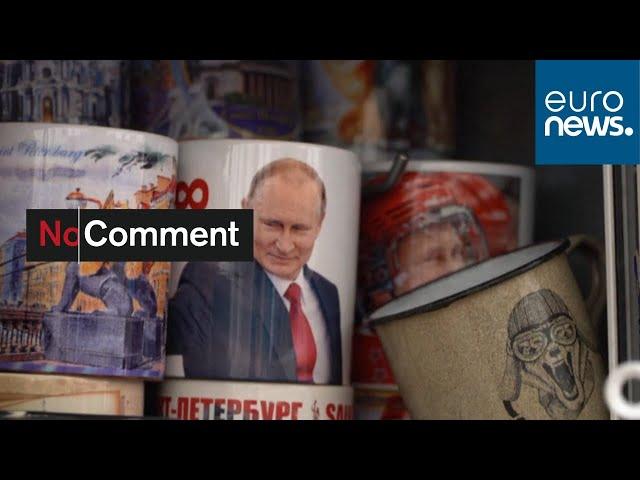 On magnets, mugs and matryoshka dolls, Putin's face still sells