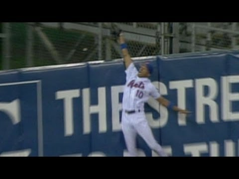 Endy Chavez makes a spectacular game-saving catch, robbing Scott Rolen of a home run.