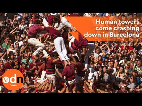 Spectacular human towers come crashing down