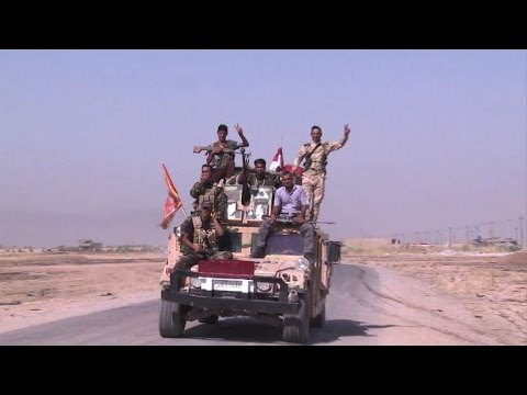 Iraqi forces bring humanitarian aid to civilians in Amerli
