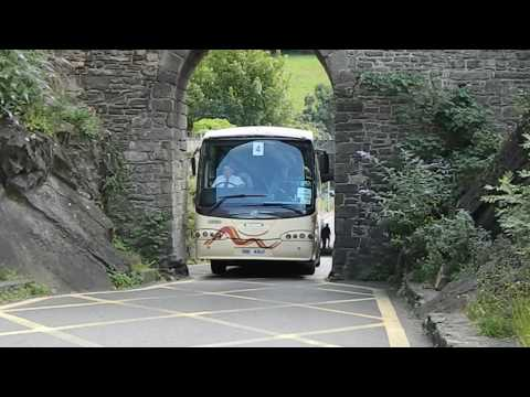 Tourist coach struggling through Conwy Town Walls Arch Wales UK