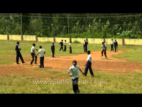 School children from South India playing cricket