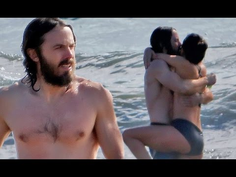 Casey Affleck kisses bikini beauty during romp in the Malibu surf after splitting with wife of 10 ye