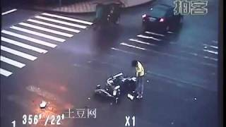 asian man crashes his motorbike into a car does a 360 flip landing on his feet