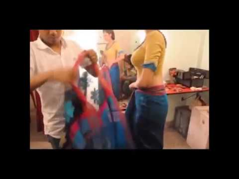 Dressing a woman  for saree photo shoot in E  commerce compa