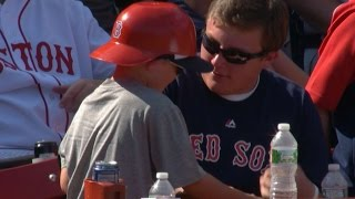 Young fan gets ball, loses hat out of joy