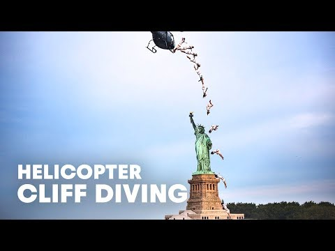 Red Bull Cliff Diver Heli-Dives in Front of Statue of Liberty