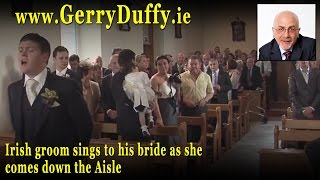Irish groom sings to his bride as she comes down the Aisle st their wedding in Ireland