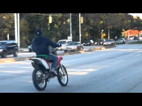 BALTIMORE POLICE SPEED UP TO HIT DIRTBIKE