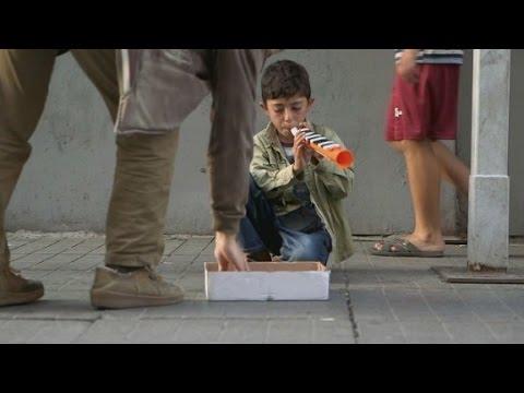 The littlest flutist, Syrian refugee boy