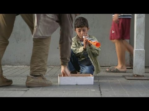 The littlest flutist, Syrian refugee boy