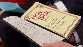 Unveiling a bible signed by Ronald Reagan