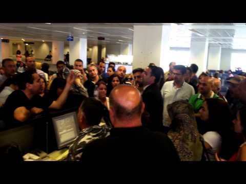 Angry passengers at Emirates Airlines counter at Beirut Airport