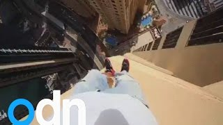 Freerunner jumps from pillar to pillar on the 43rd floor of Dubai hotel