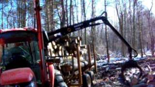 MACHINE LOGGING OPERATIONS ON KLINE RD WITH FARMER BROWN STUMP VIDEO
