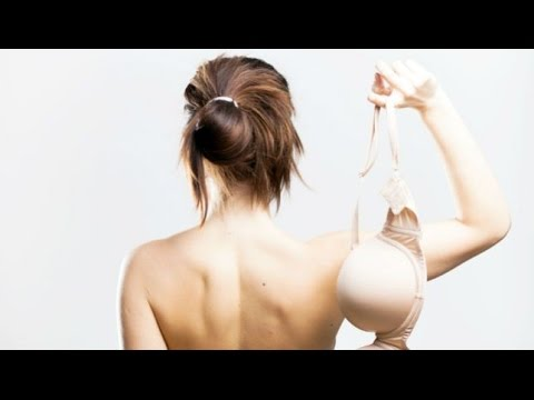 Women remove their bras, as some have been required to do recently.