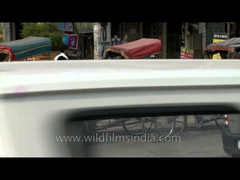 Rickshaw-pullers waiting for passenger outside GTB Nagar metro station