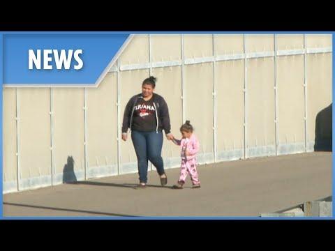 Migrant mother and child breach U.S. border