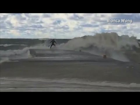 Surfers struggle with huge waves at Lake Huron