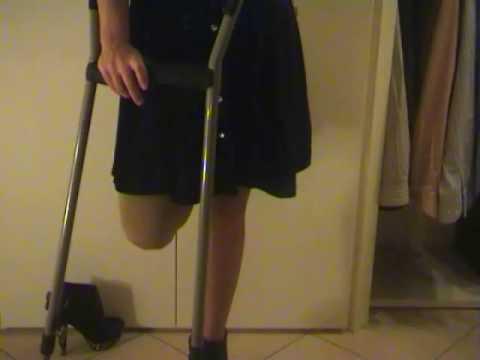 Lak amputee walking whit one crutch 2