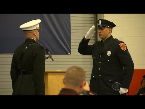 Double-amputee Marine vet graduates from N.Y. police academy