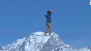 Two Men Walk From one Mountain to Another on Tight Rope