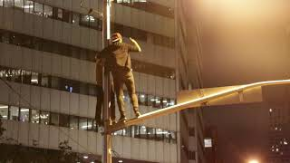Fans climb light posts near Union after Raptors win NBA Championship