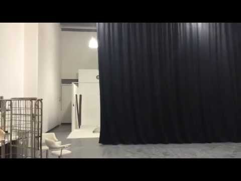 Shop Direct installation of curved stage curtain track with blackout curtains