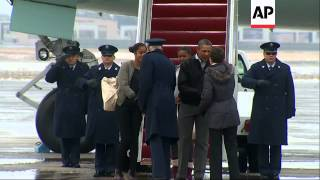 Vacation over, President Barack Obama and his daughters returned to Washington Sunday. (Jan. 5)