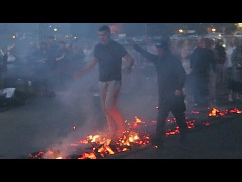 WALKING ON FIRE WITH BARE FEET