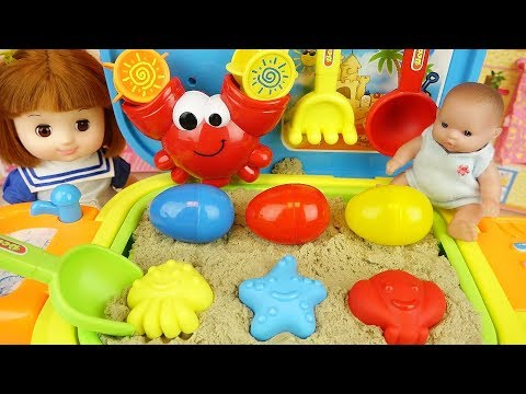 Baby doll sand play bag and surprise eggs toys play
