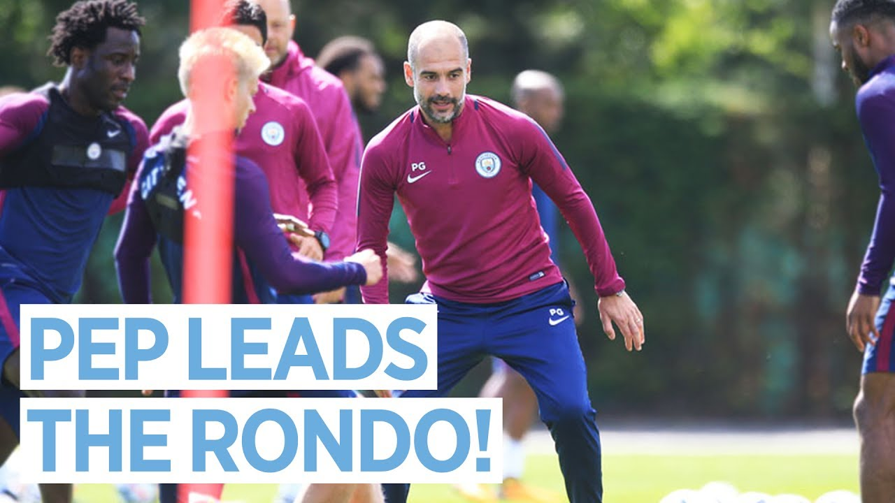 Pep Guardiola joins in Rondo during Manchester City pre-season