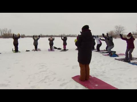 Yoga Lovers Bundle Up For a Wintery Class on Icy Pond