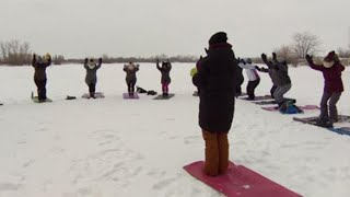 Yoga Lovers Bundle Up For a Wintery Class on Icy Pond thumbnail