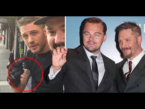 Tom Hardy shows off 'Leo Knows All' tattoo as he loses bet to Leonardo DiCaprio