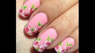 Facil diseño de uñas con rosas blancas y rojas thumbnail