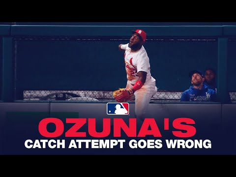 Ozuna's Catch Attempt Goes Awry