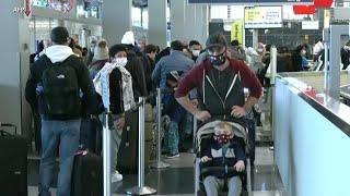假日期间出现繁忙旅行 疫苗虽到手感染已增加 - YouTube
