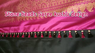 Saree kuchu design using stone beads