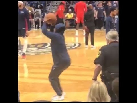 Tony Roberts snuck on to the court and put up a shot before the police escorted him