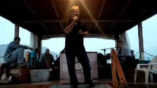 Tim Livingston singing on a boat on The Sea of Galilee