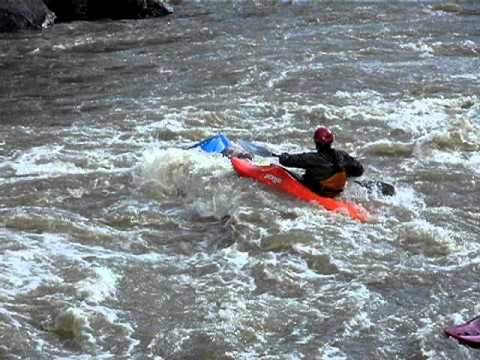 Kayaker swims Powerline Rapid in the Taos Box on the Rio Grande